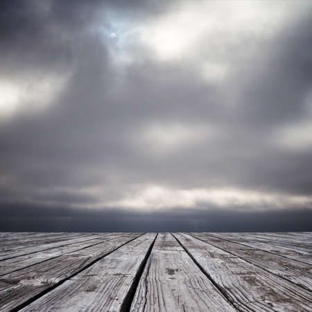 somber: wood floor and somber sky