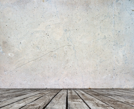 gray concrete wall and wood floor
