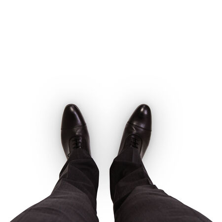 businessman feet in black boots on the floor Stock Photo