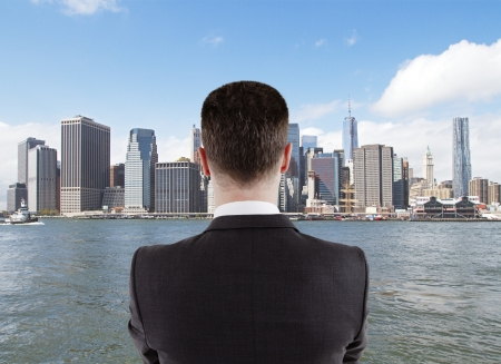 young businessman looking to the big city