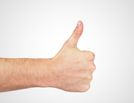 hand with thumb up isolated on white photo
