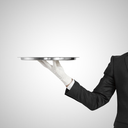 hand holding  silver plate on a white background Stock Photo