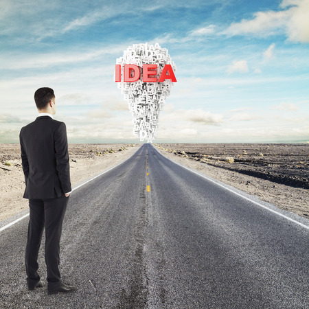 businessman standing on road looking to idea photo