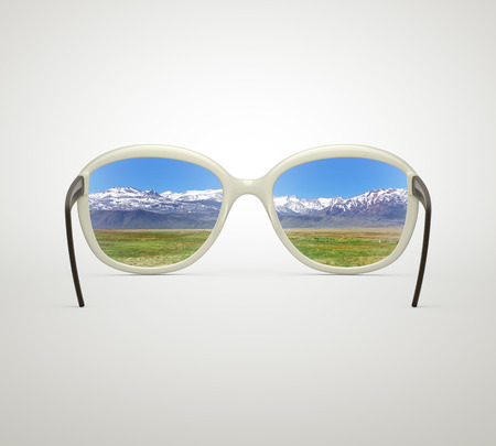 black glasses looking to nature photo