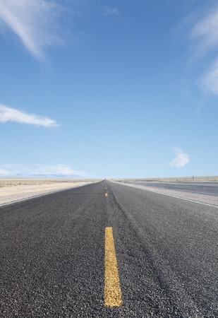 big road with yellow arrow photo