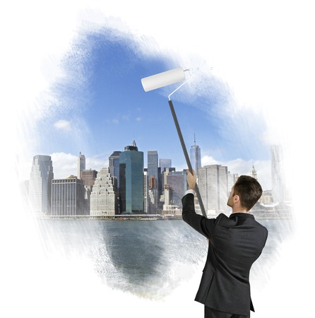 businessman painting window  to modern city photo