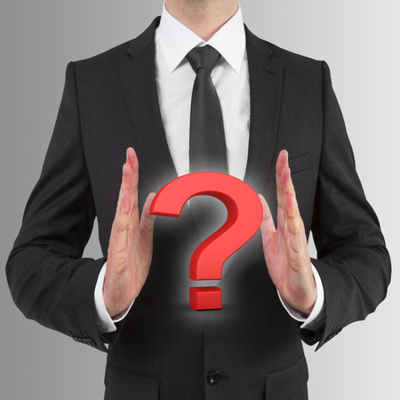 businessman holding red question mark photo