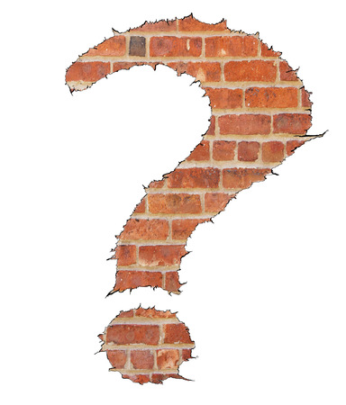 question mark symbol  on a brick background photo