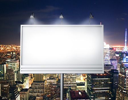 Billboard with empty screen, against modern city photo