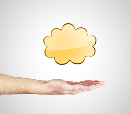 hand shows gold  cloud on a white background photo
