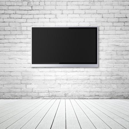 blank wide screen TV on brick wall in room