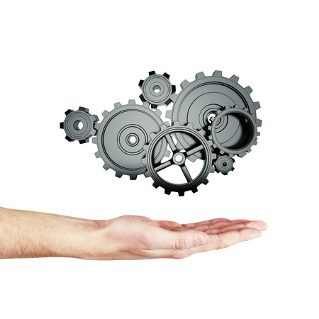 rack wheel: hand holding metal gears and cogwheels on white background