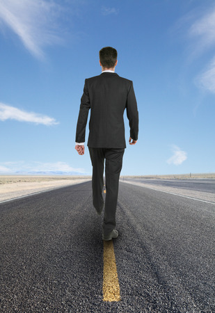 horizont: young businessman walking on road looking to horizont