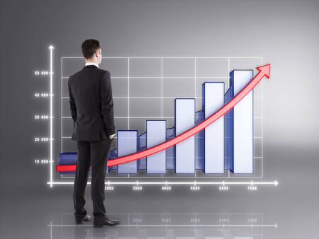accounting symbol: businessman in suit looking on chart Stock Photo