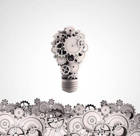 Business ideas and concepts featuring a light bulb with gears and cogs photo