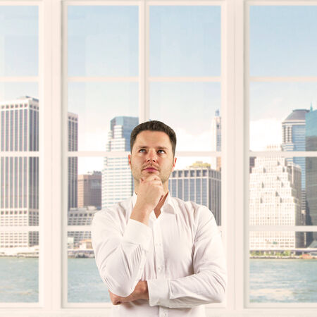 businessman thinking on a city background photo