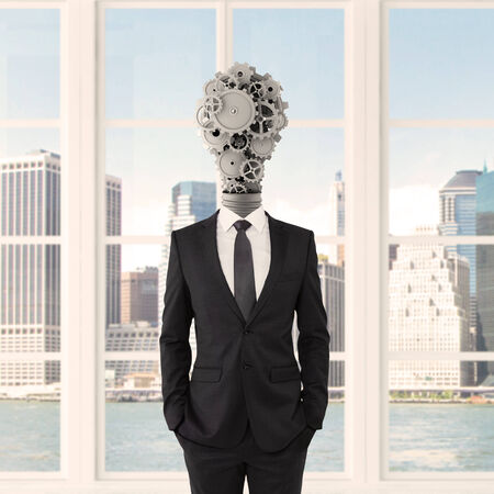 businessman with lamp-head in form gears photo