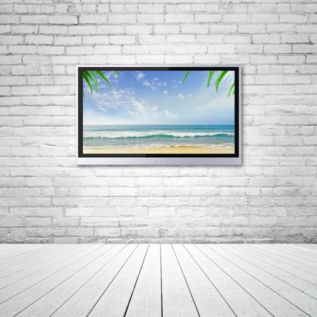 wide screen TV with travel background concept photo