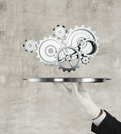 rack wheel: hand holding silver tray and metal gears