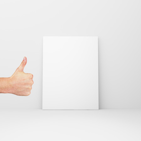 amaged: blank paper in a white room with thumbs up