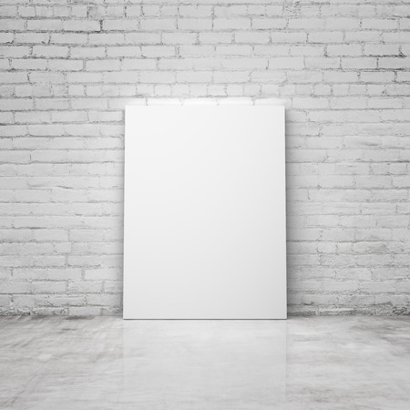 amaged: blank poster in a brick room Stock Photo