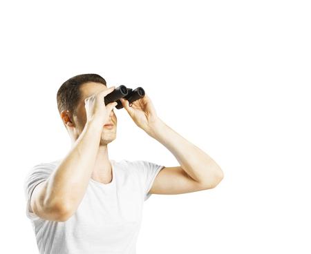 man looking through binoculars  on whit background photo