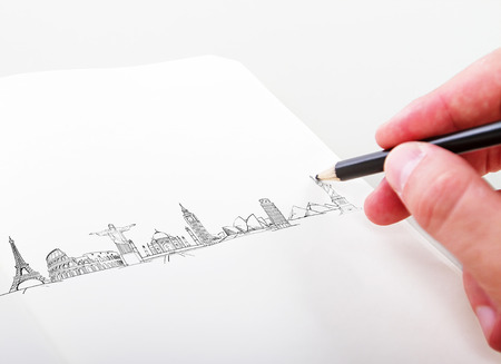 pise: hand drawning travel landmarks in a paper