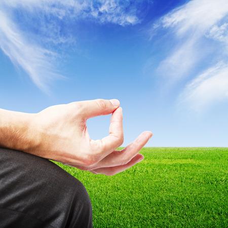man in meditation on green field  background photo