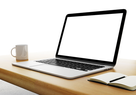 laptop with cup and diary on table