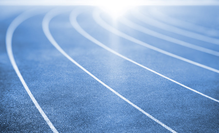 sports race: blue running track for athletics and competition Stock Photo