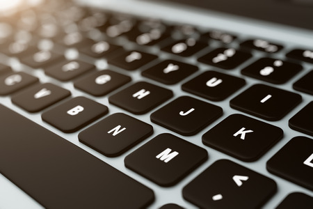Close up of modern notebook black keyboard