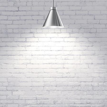 witte bakstenen muur met plafondlamp
