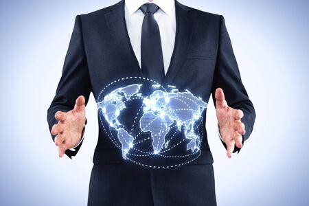 businessman holding world map interface on blue background photo