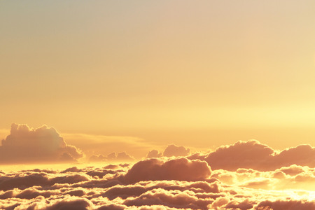 yellow: beautiful yellow sky background with a clouds