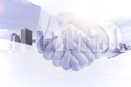 building trust: business handshake on a city background, double exposure Stock Photo
