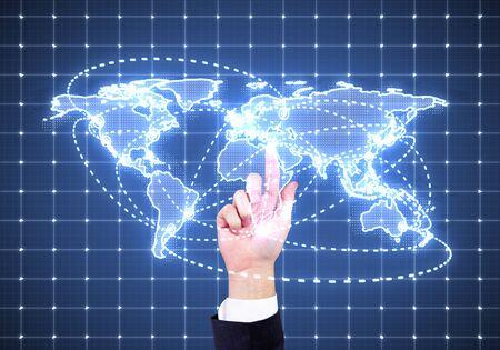 hand pushing world map interface on screen photo