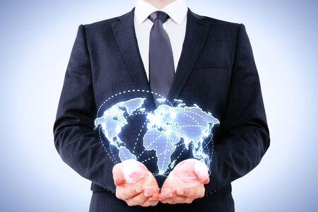 businessman holding digital map on blue background photo