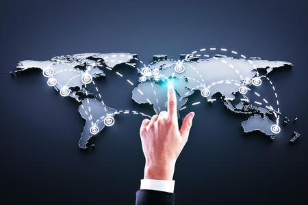 hand pushing world map interface on blue background photo