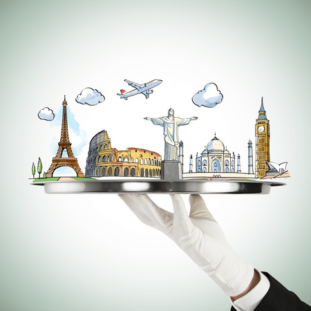 hand holding silver plate with  travel  concept