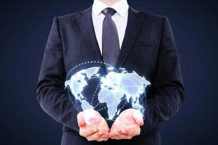 businessman holding digital world map on blue background photo