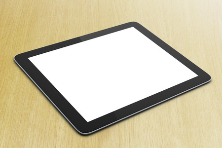 blank digital tablet on a yellow table