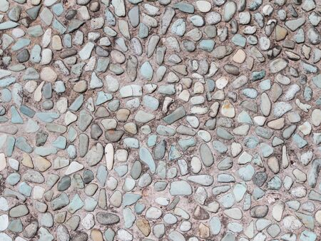 river rock: Stone wall background Stock Photo