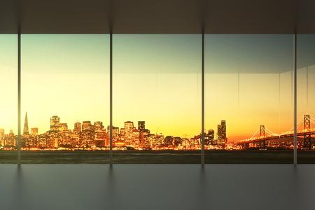 empty glass: oficina vacía al atardecer con vistas a la línea del horizonte Foto de archivo