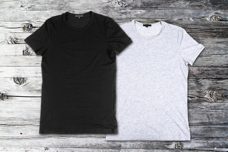 blank t-shirts on the wooden background