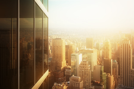 commercial: Cityscape reflected in the glass of an office building at sunset