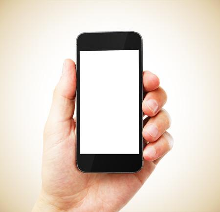 celulas humanas: mano con el tel�fono celular en blanco Foto de archivo