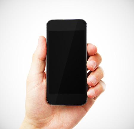 hand with empty phone on white background Stock Photo