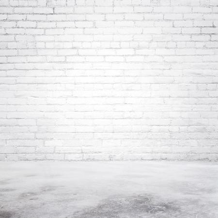 interior spaces: empty white brick room and concrete floor