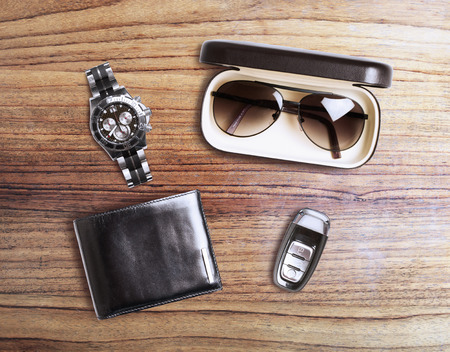 set of mens accessories on a wooden background
