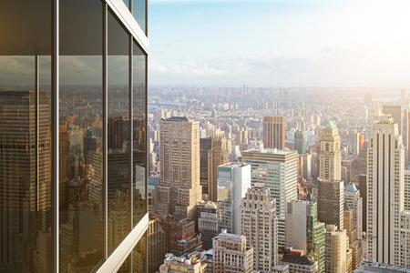 modern buildings: Modern glass office building and view to city Stock Photo